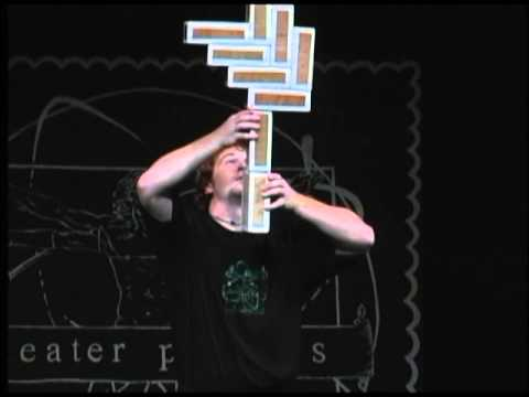 A student performs a block balancing trick at Theatre Physics 9 (2002)