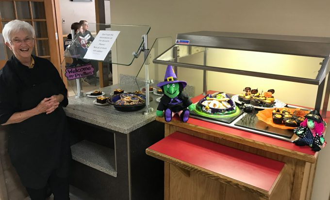 Judy Hed with cafeteria Halloween treets.