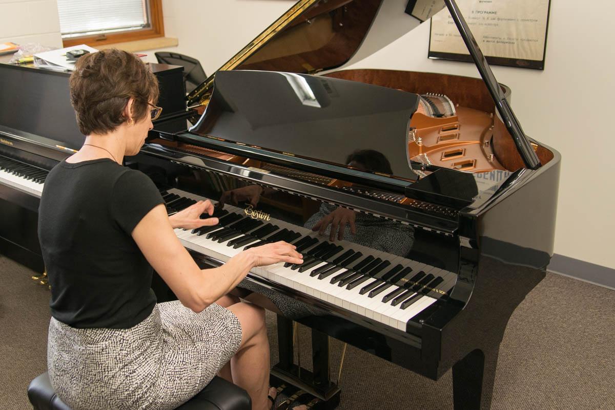 Dr. Bethel Balge at the new Boston piano.