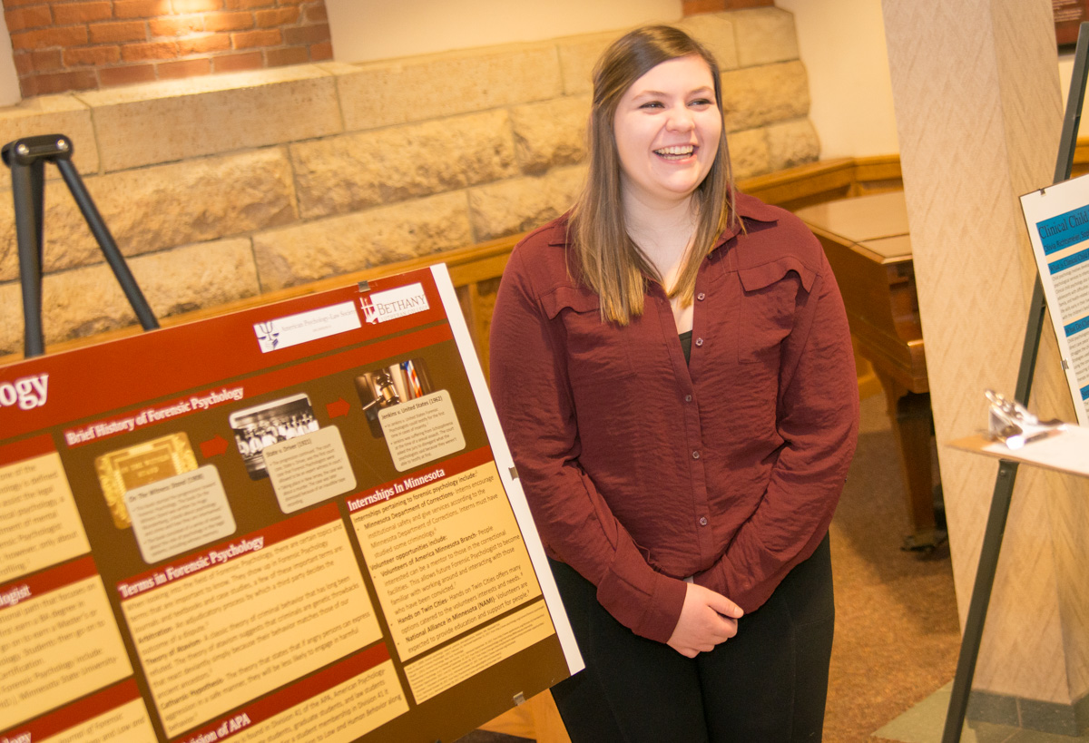 Junior Hayli Mathe at the poster session in Old Main.