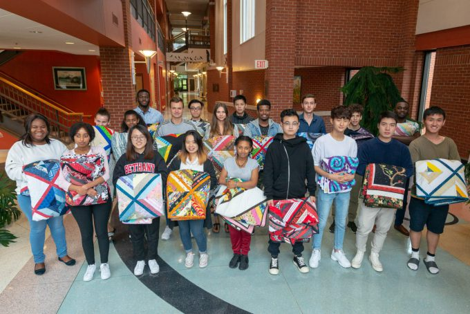 International students with their hand-made quilts.