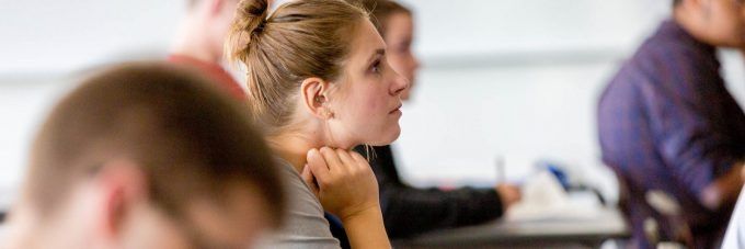 Female student listens during class