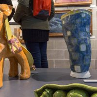 Ceramic sculptures on display in the Ylvisaker Fine Arts Center Gallery during a student art show