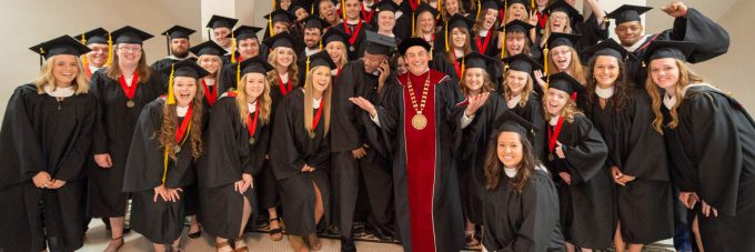 Graduates with President Gene Pfeifer in Old Main