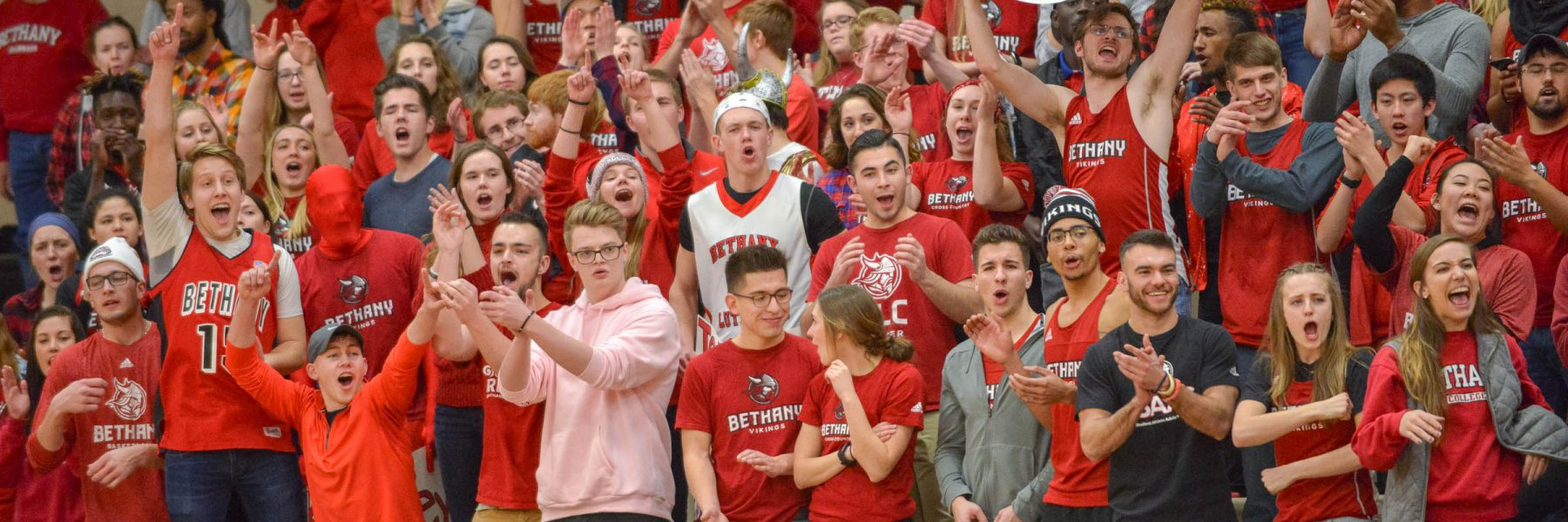 Fans at basketball game in North Gym of Sports and Fitness Center