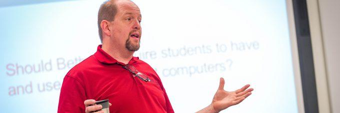 Professor Jon Loging teaching in class.