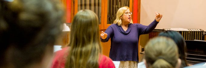 Ann Frederickson, a professor in the BLC Music Department, directs the Mary Martha Singers choir during a practice.