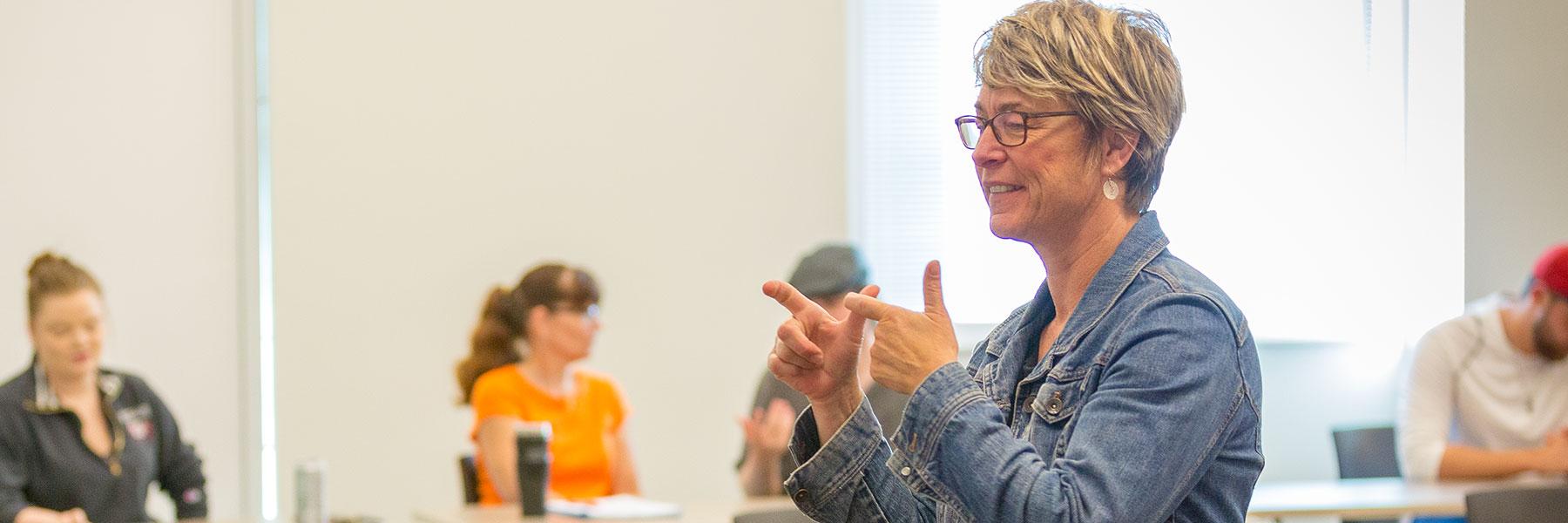 Crista Browne-Krosch, an instructor in the BLC American Sign Language department, teaches an ASL class.
