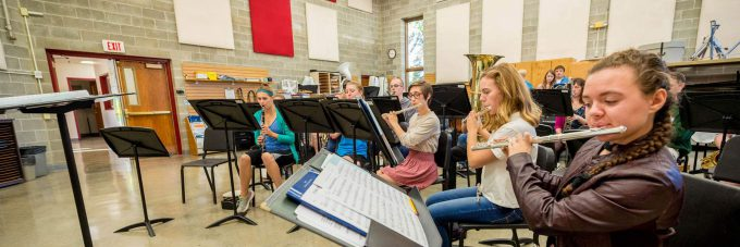 Bethany Band students practice in the Ylvisaker Fine Arts Center's band room.