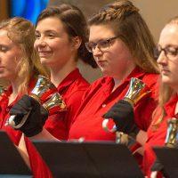 Handbell choir playing in Trinity Chapel.