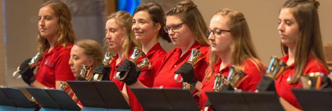 Handbell choir playing in Trinity Chapel.