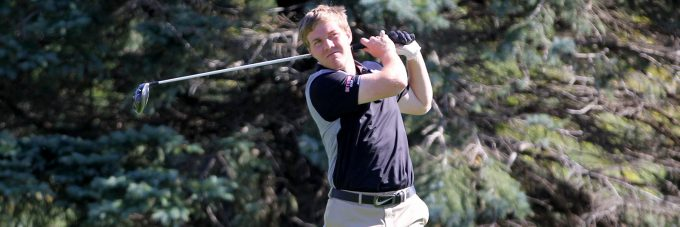 A Bethany Vikings Men's Golf player takes a swing on the course.