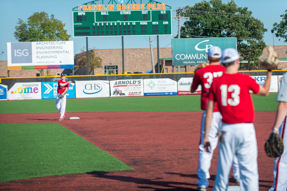 baseball players practicing on a field