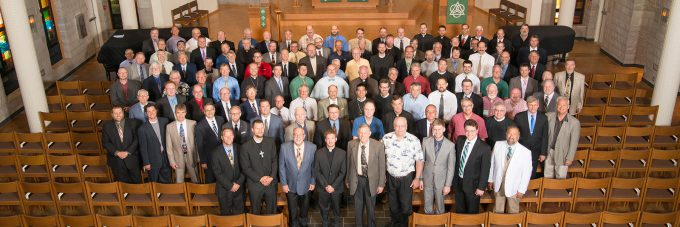 Pastors of the Evangelical Lutheran Synod pose for a group photo inside Trinity Chapel