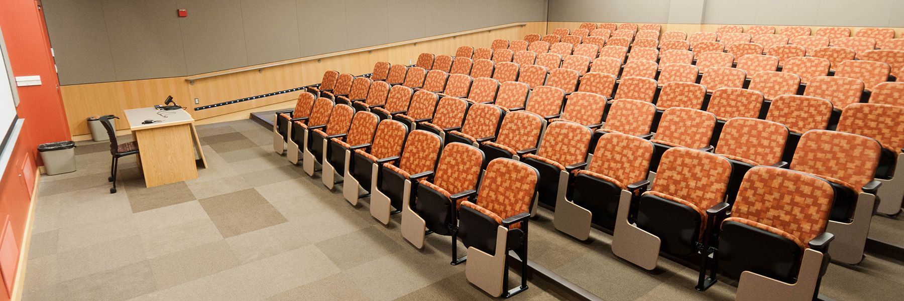 Film viewing room with theatre-style chairs