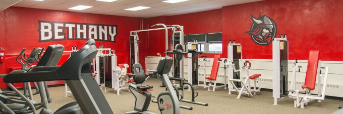 exercise equipment in a room with red walls