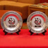 athletic hall of fame awards set on a table