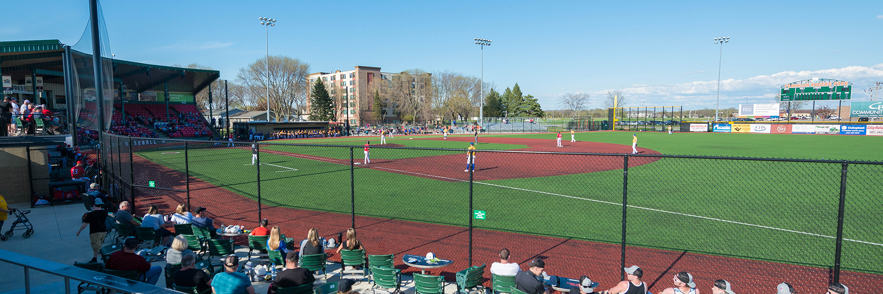 baseball field with players and fans