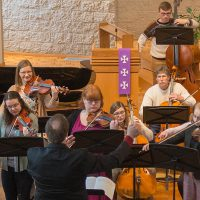 band members play musical instruments in chapel