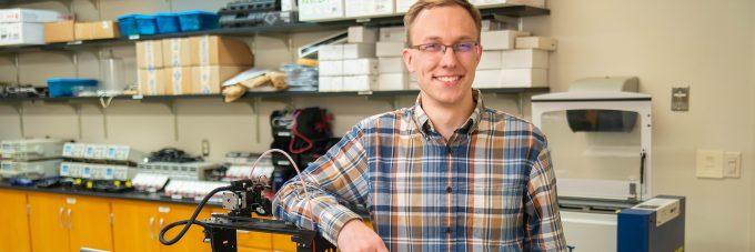Student Daniel Halvorson smiling in physics lab