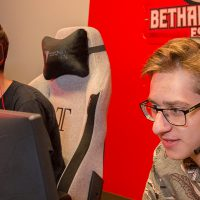 students with headsets on compete in an online video game competition practice while looking at video monitors.