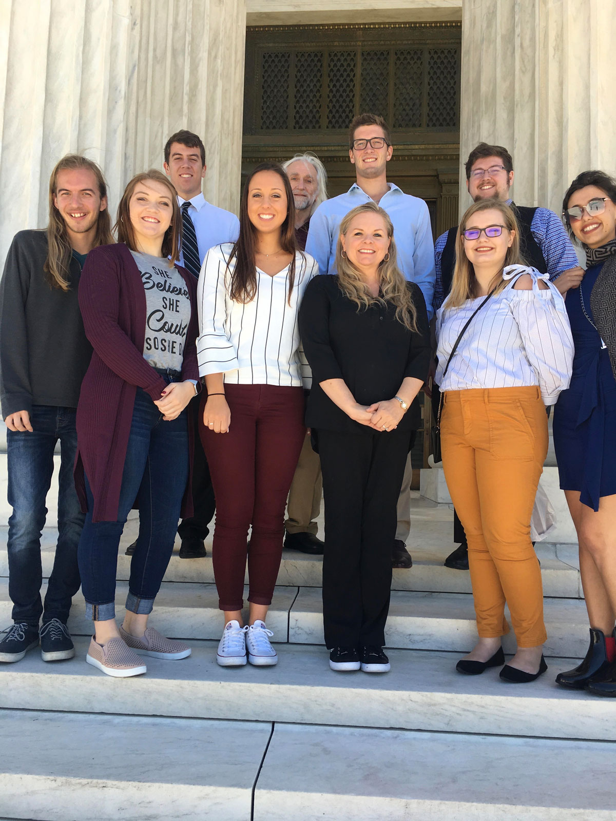 Group photo of students and faculty in the BLC Legal Studies Department, standing on courthouse steps