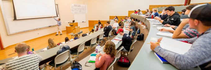 Professor Doyle Holbird teaching in large classroom of meyer hall.