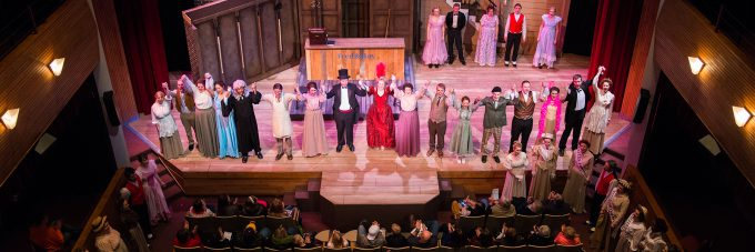Theatre actors take a bow onstage after a production