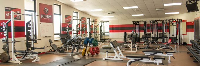 weight room with weights and benches for working out