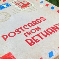 "2018 yearbook cover, ""Postcards from Bethany."""