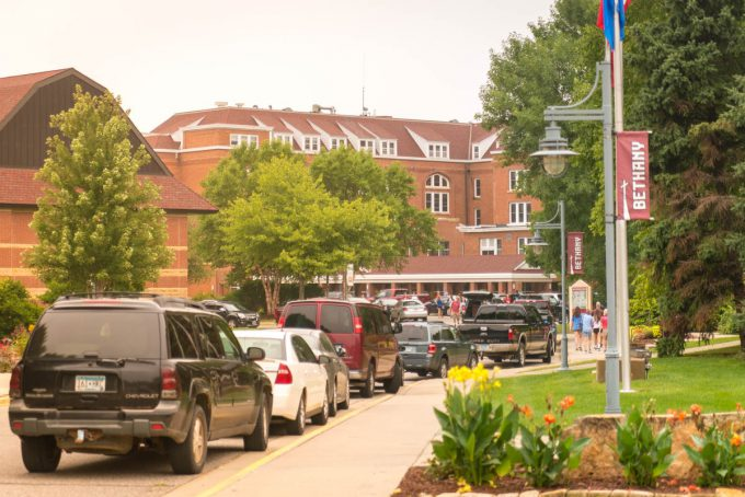 Bethany Lutheran College campus road filled with student and parent vehicles and pedestrians during residence hall move-in day
