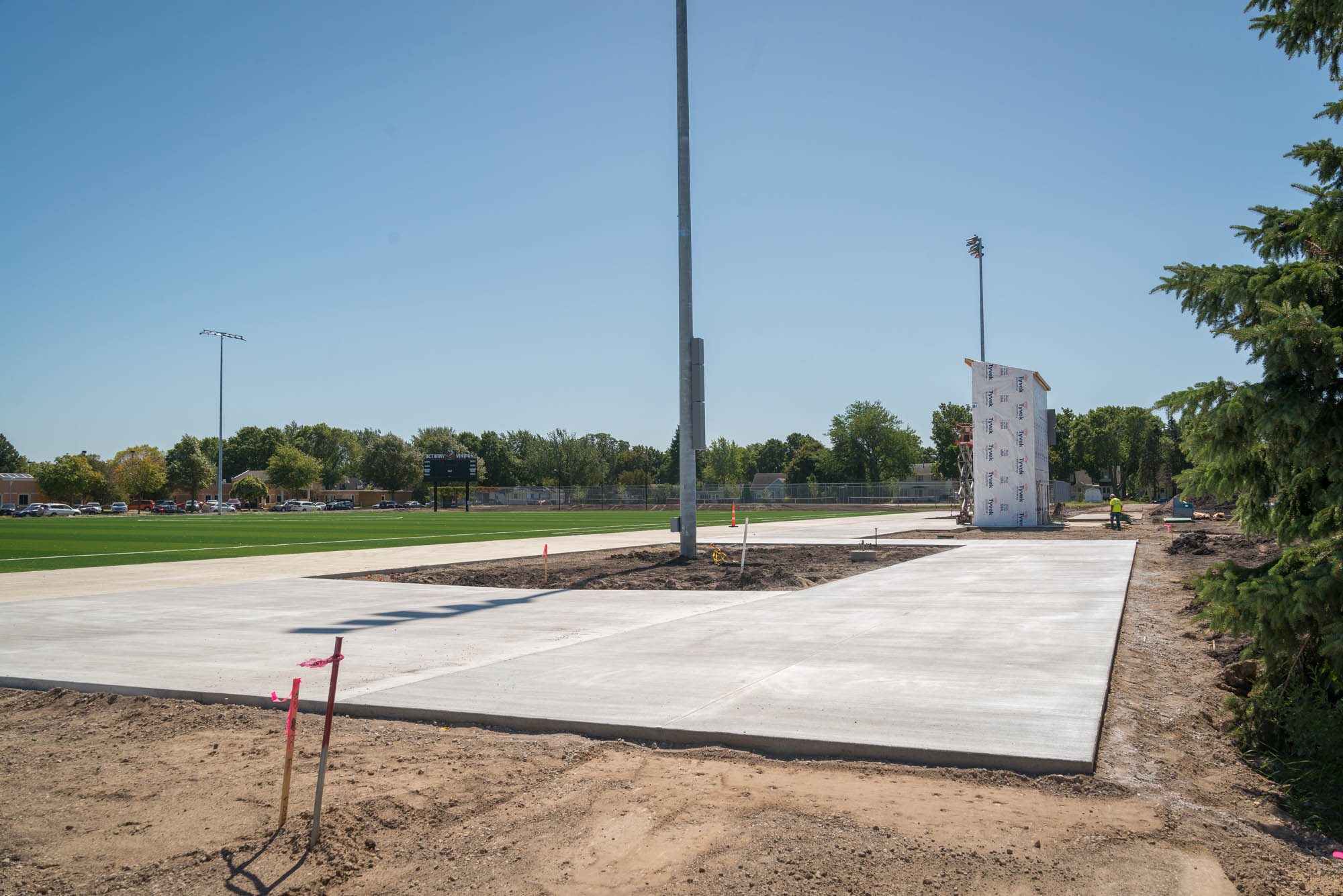 Concrete slabs surround a lightpole by the new pressbox at the new Bethany Soccer field.