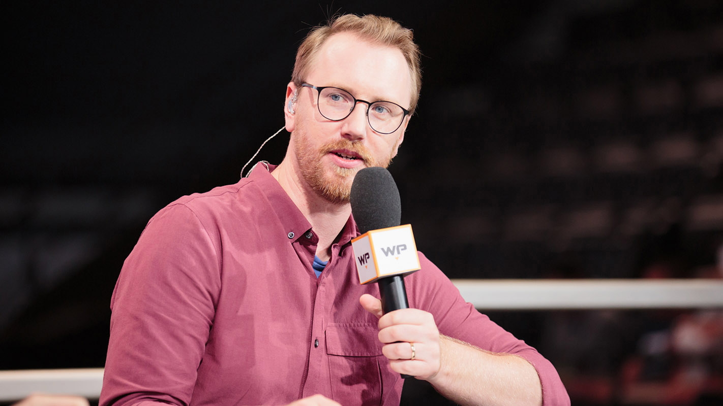 "Esports caster Erik ""DoA"" Lonnquist speaking into a microphone"