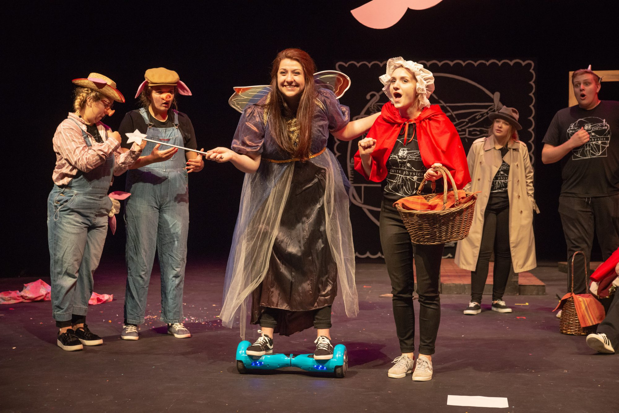 Six actors on stage perform a fairy tale mashup during Theatre Physics 26.