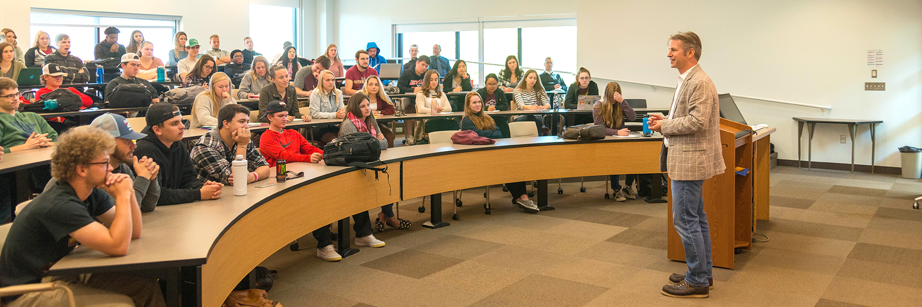 """""""Meet a German"""" Day speaker Max Gruenig, President of Ecologic Institute US speaks with students in a classroom."""