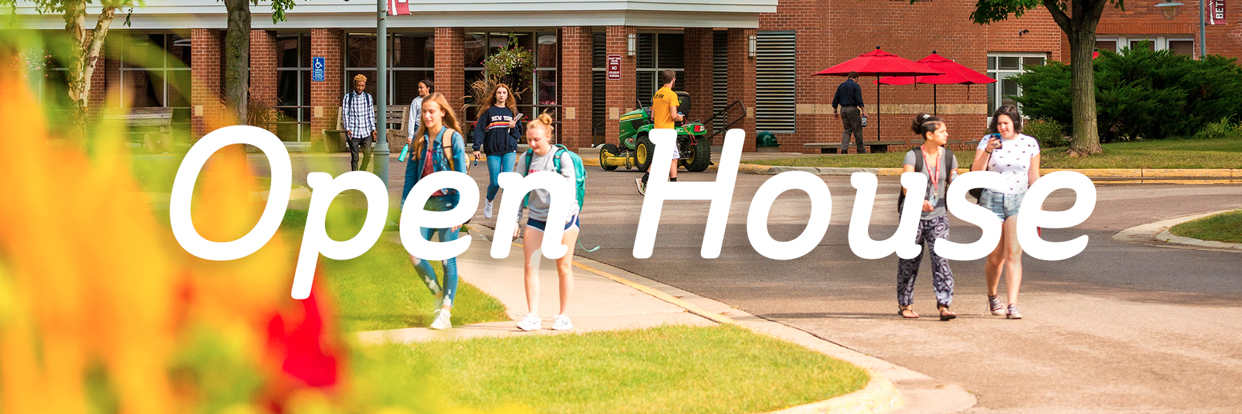 """photo of students walking outside with the text """"open house"""" on top"""