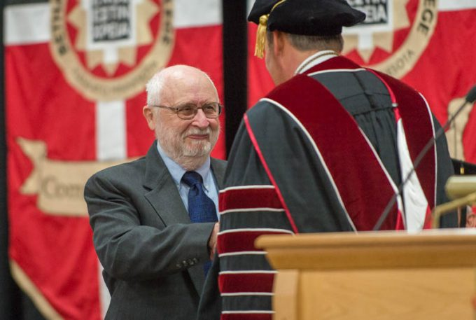 Darwin Beck receives the Distinguished Alumnus Award from Bethany President Gene Pfeifer during the 2019 Spring Commencement Ceremony.