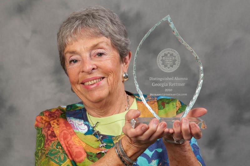 Georgia Rettmer holding the Distinguished Alumna award in 2010.
