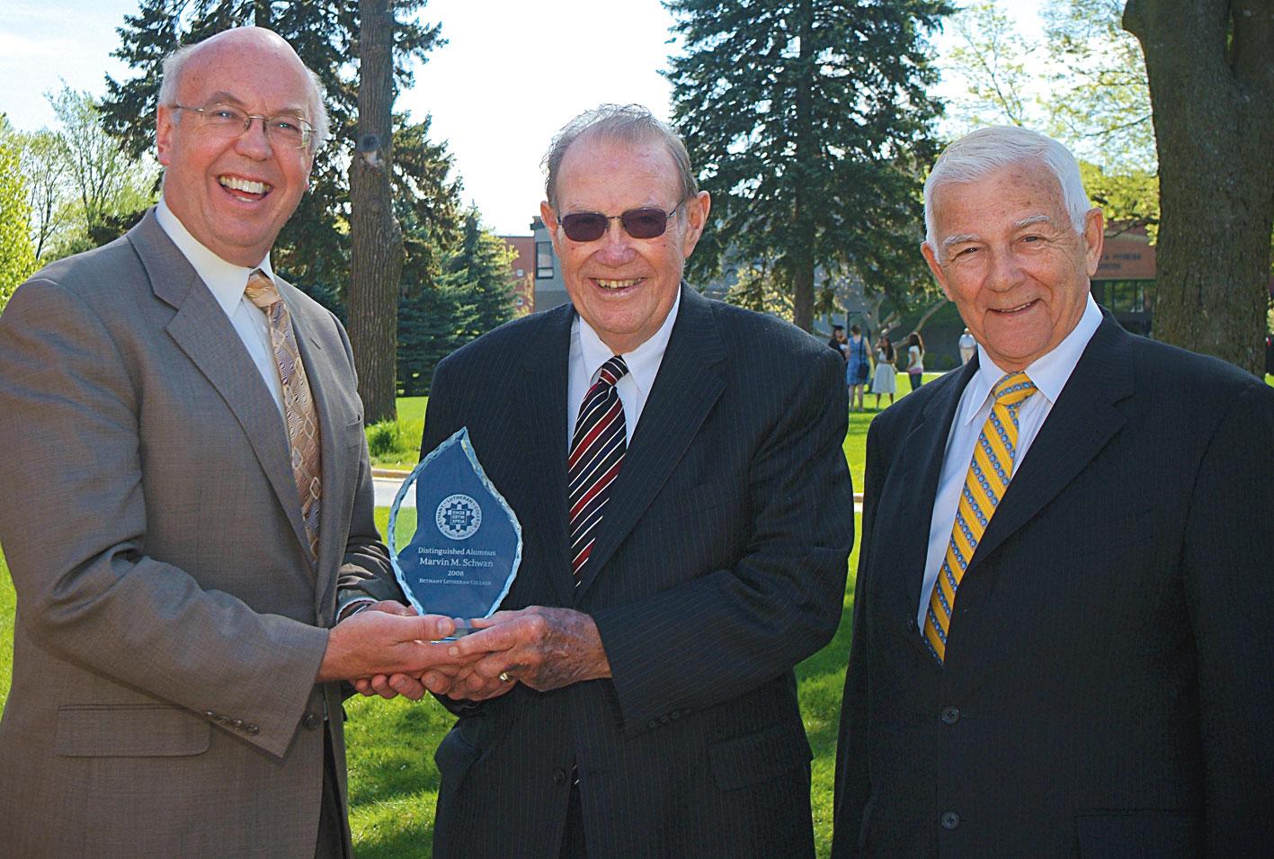 From left: President Dan Bruss, Alfred Schwan, and commencement speaker Rev. Larry Burgdorf. (2008)