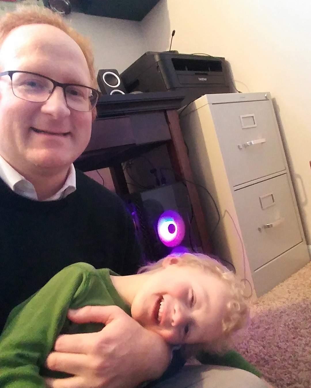 Professor Nick Proksch with his son at home