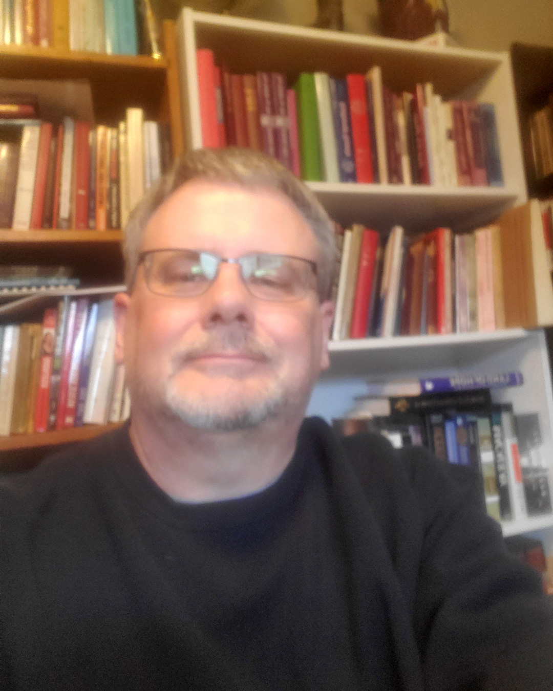Rev. Tom Rank in his home office surrounded by books