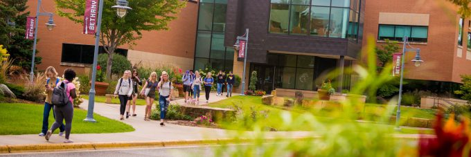 students walk across campus outside of Honsey Hall