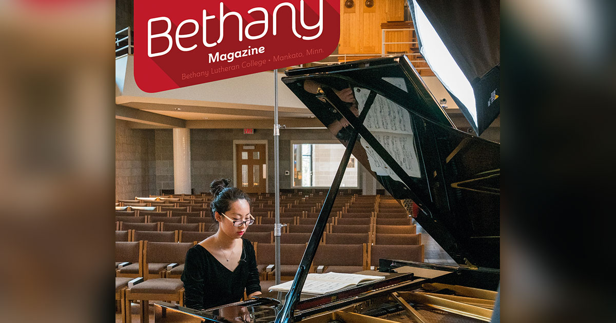 a student plays piano in trinity chapel on the cover of the july 2020 bethany magazine