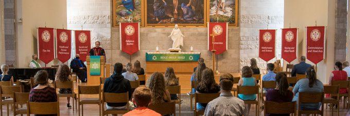 President Gene Pfeifer talks to students and staff in Trinity Chapel