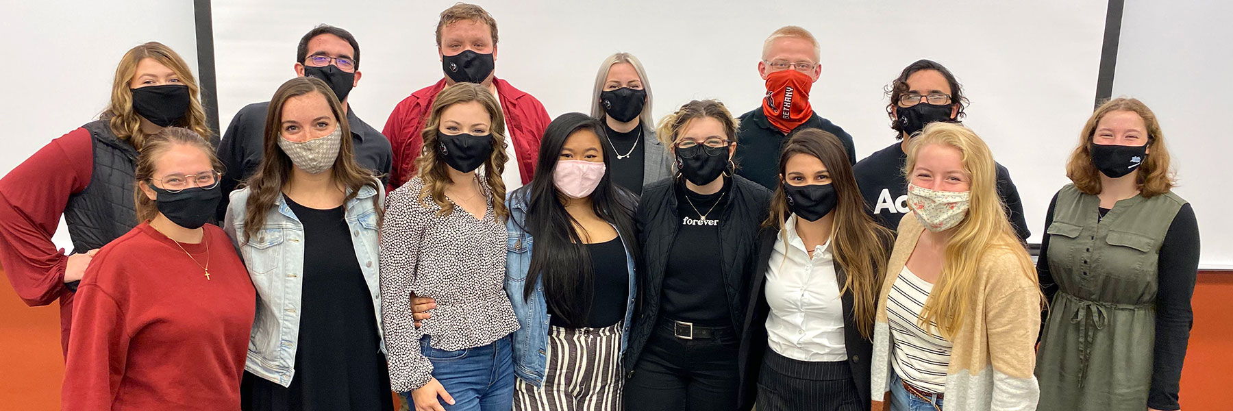 Photo of students with masks on in a group representing student senate