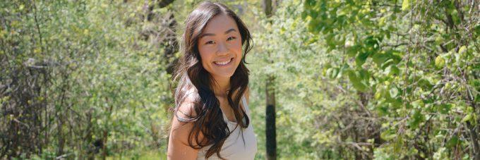 Veeva Lee portrait photo outside among trees