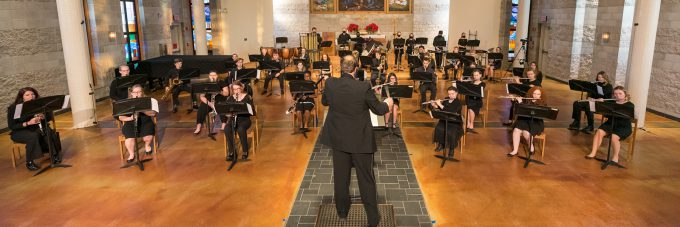 Concert band performing in Trinity Chapel