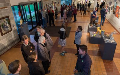 Visitors look around the Ylvisaker Fine Arts Center Gallery during a student art show
