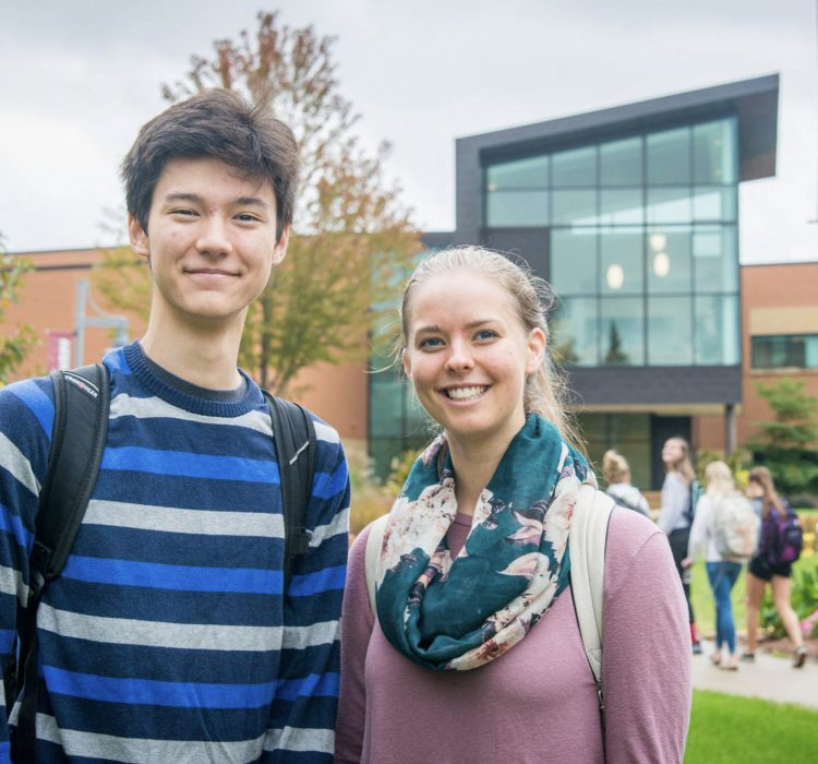 two students in front of Honsey Hall